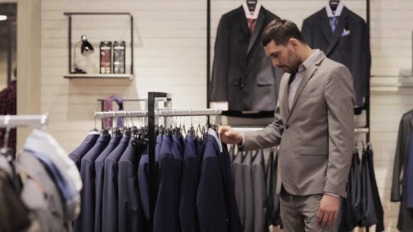 Thumbnail for Young Man Choosing Clothes In Clothing Store 8