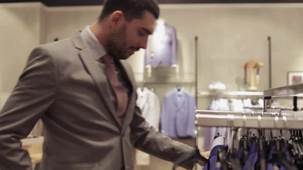 Thumbnail for Young Man Choosing Clothes In Clothing Store 29