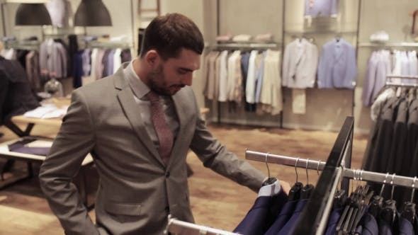 Thumbnail for Young Man Choosing Clothes In Clothing Store 13