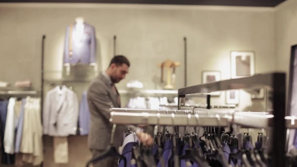 Thumbnail for Young Man Choosing Clothes In Clothing Store 31