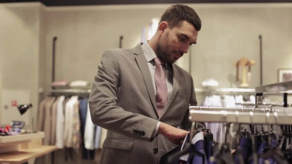 Thumbnail for Young Man Choosing Clothes In Clothing Store 30