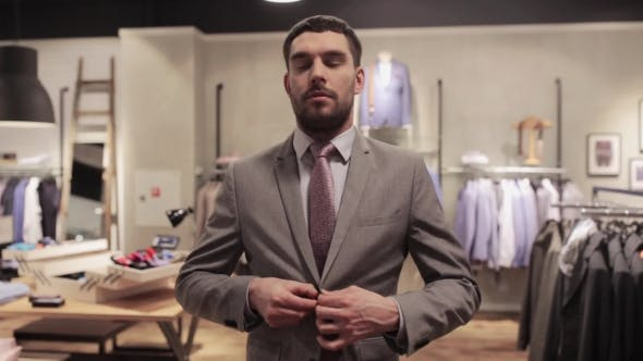 Thumbnail for Happy Young Man Trying Suit At Clothing Store 11