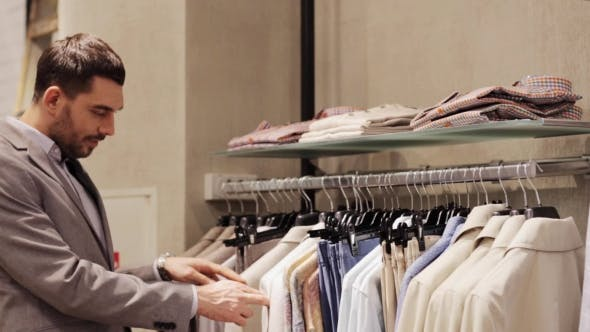 Thumbnail for Happy Young Man Choosing Clothes In Clothing Store 5