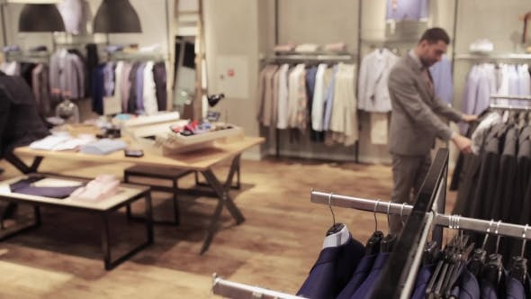 Thumbnail for Young Man Choosing Clothes In Clothing Store 15