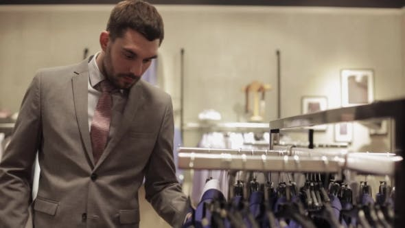 Thumbnail for Young Man Choosing Clothes In Clothing Store 32