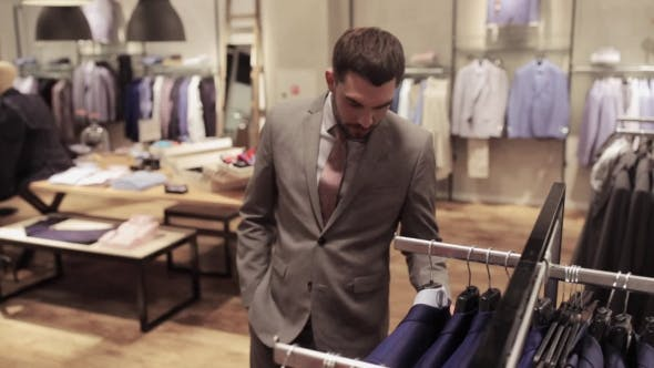 Thumbnail for Young Man Choosing Clothes In Clothing Store 16