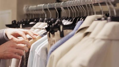 Man Choosing Clothes In Clothing Store 6