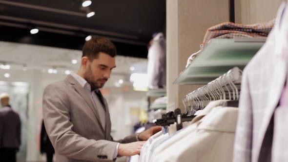 Thumbnail for Young Man Choosing Clothes In Clothing Store 19