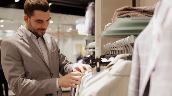 Thumbnail for Young Man Choosing Clothes In Clothing Store 22