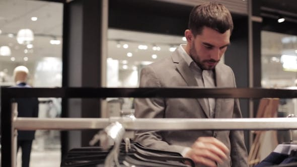Thumbnail for Young Man Choosing Suit In Clothing Store Or Mall 24