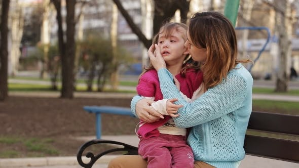 Thumbnail for Little Girl Crying Sitting On Mother's Her Lap