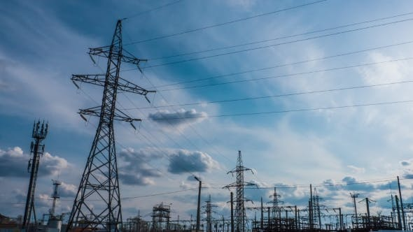 tower of power station at sunset. timelapse. energy technologies. solar energy
