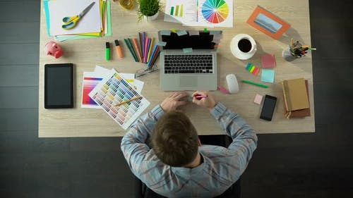 Inspired Male Creator Writing Down All His Ideas on Piece of Paper to Remember