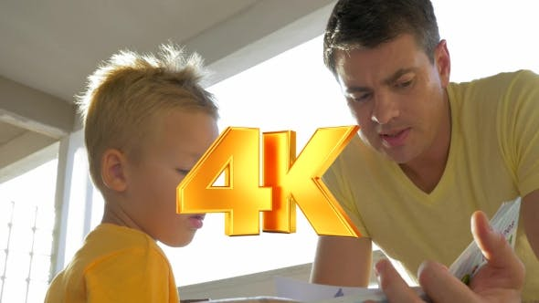 Thumbnail for Father And Child Spending Leisure With Book