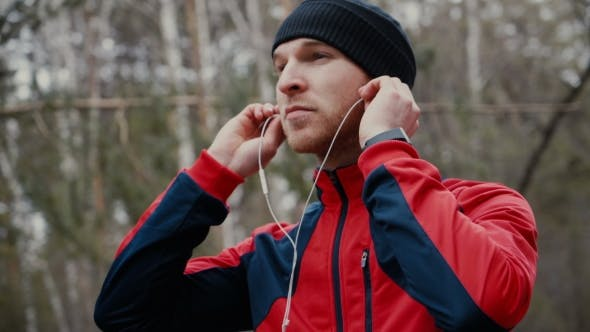 Thumbnail for Man Setting The Music Playlist For The Workout.