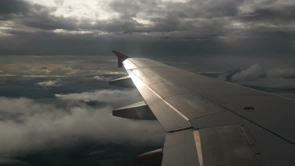 Airplane Wing Above Cloud