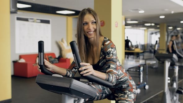 Thumbnail for Beautiful Woman At The Gym On Bike