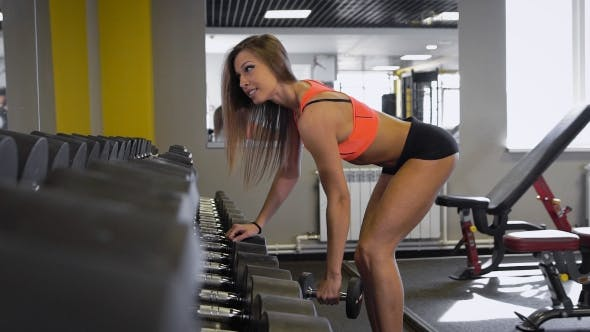 Thumbnail for Sporty Girl Doing Exercise With Dumbbells In The Gym