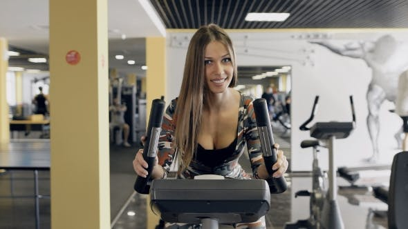 Thumbnail for Beautiful Woman At The Gym On Bike, Cycle, Sunny Gym.