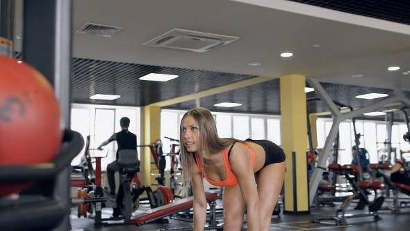 Thumbnail for Woman Working Out At a Gym With Exercise Equipment