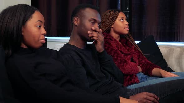 Thumbnail for Three African Friends Watch Television in Living Room and They Are Angry