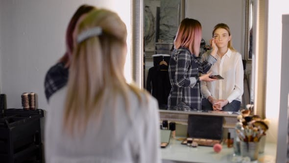 Thumbnail for Professional Make-up Artists Working With a Brush.