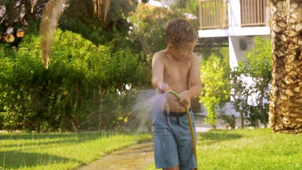 Thumbnail for Boy Watering the Lawn and Getting Wet