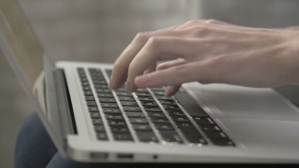 Thumbnail for Shot Of Female Hands Typing On a Laptop