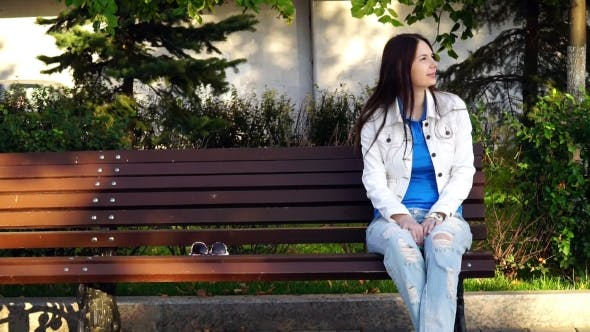 Thumbnail for Beautiful Girl Sitting On  Bench In The Park