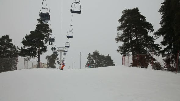 Thumbnail for Skiers And Snowboarders Skiing Downhill