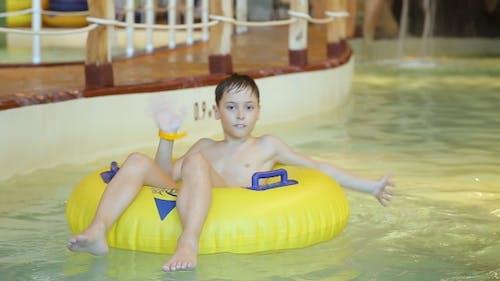 Boy Plays In Aqua Park