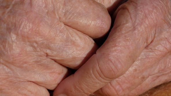 Thumbnail for Grandmother massages painful hands