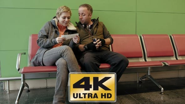Thumbnail for Couple Waiting At Airport Terminal With Tickets