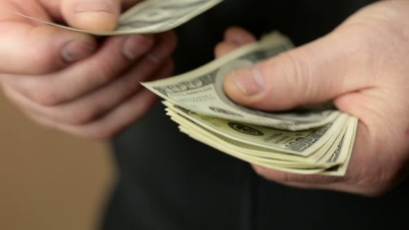 Thumbnail for Male Hand Counting Money