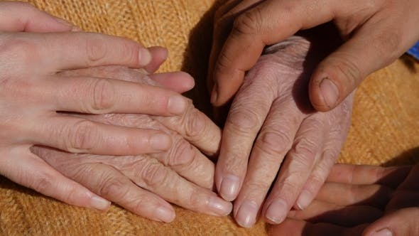 Cover Image for Male And Female Hands Comforting a Old Pair Of Hands