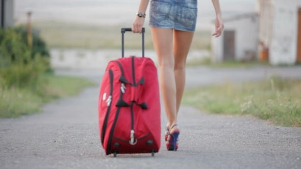 Thumbnail for Sexy Girl With Suitcase Walking On The Driveway
