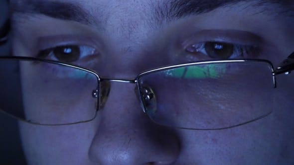 Thumbnail for Shot Of Man In Glasses Surfing Internet At Night