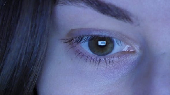 Thumbnail for Girl's Eye Reading Internet, With Reflection Of Screen In Her Eye At Night