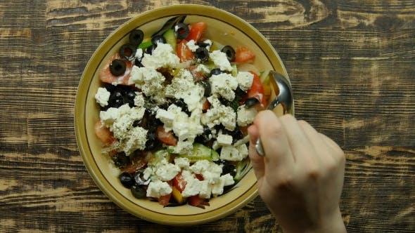 Thumbnail for Female Hand is Stirring Fresh Vegetable Salad