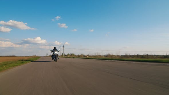 Thumbnail for The Sky, The Road And The Bike