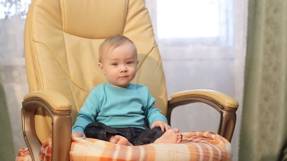 Thumbnail for Little Boy Sitting In A Chair