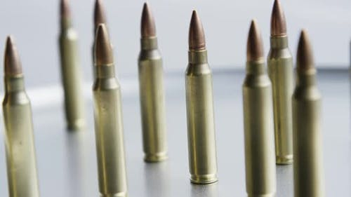 Cinematic rotating shot of bullets on a metallic surface - BULLETS 061