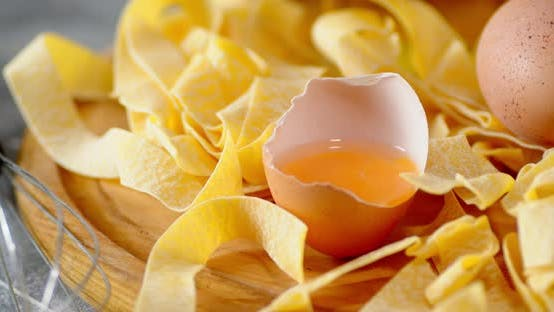 Dry Fettuccine Pasta with Egg Rotates Slowly.