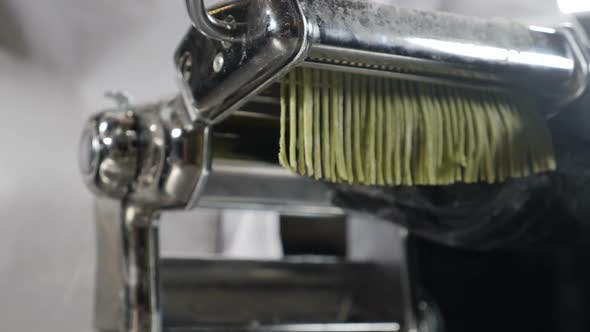 Thumbnail for Traditional Italian Cuisine. Making Homemade Pasta, Close-up of Chef Makes Pasta Using Steel Machine