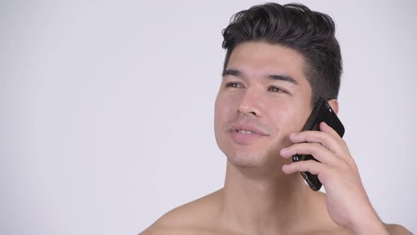 Face of Happy Young Shirtless Muscular Man Talking on the Phone