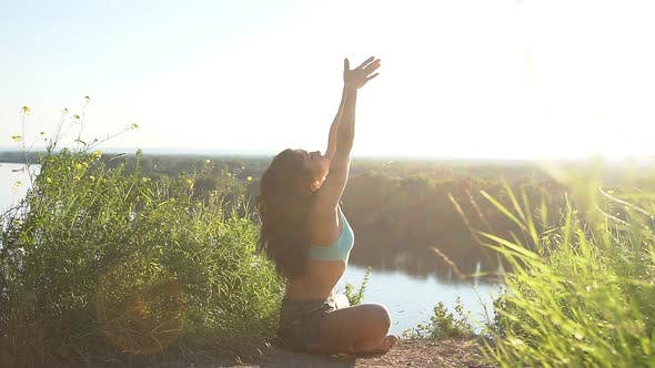 Thumbnail for Healthy Woman Meditating in Pose Lotus Over at Sunset. Slow Motion