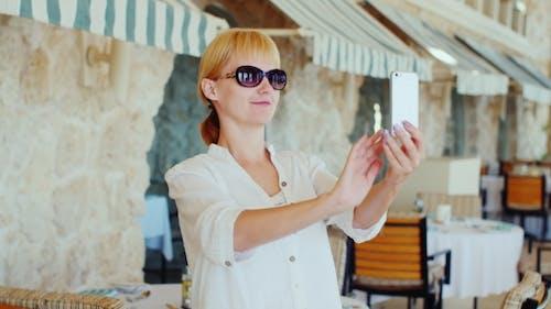 Woman Tourist In The Background Makes Selfie Italian Restaurant