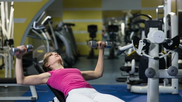Thumbnail for Fit Attractive Woman Lying On Exercising Device