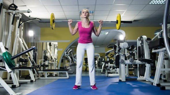 Thumbnail for Young Woman Squatting With Barbell