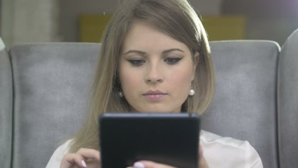 Thumbnail for Portrait Of Young Beautiful Smiling Woman Using Skype On Tablet PC
